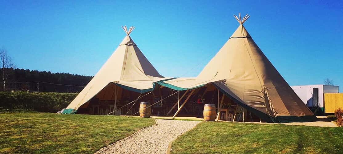 tipi marquee on a summer day