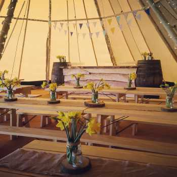 tipi interior with daffodils