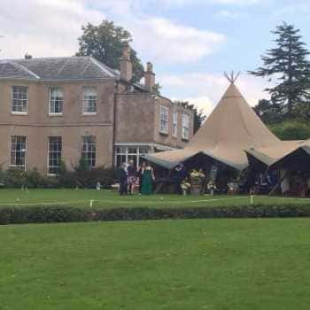 tipi in country house grounds