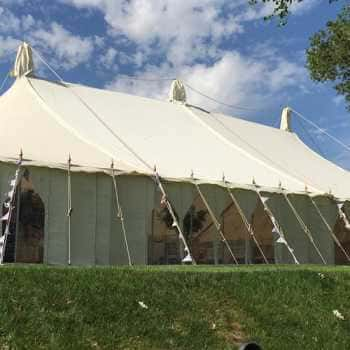 traditional marquee with bunting on guy ropes
