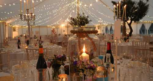 traditional marquee with fairy lights on canopy